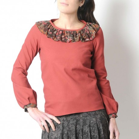 Long sleeved burnt orange shirt with ruffled collar