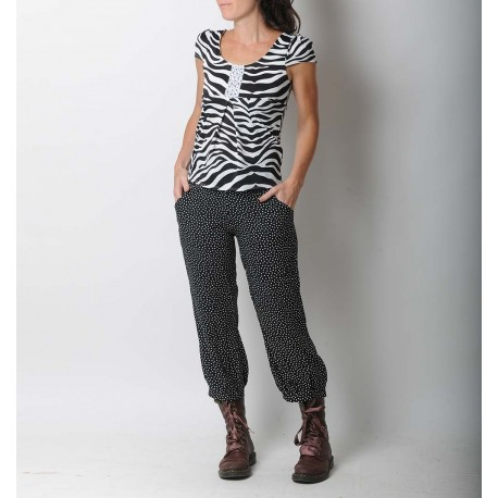 Women' s supple black pants with white dots
