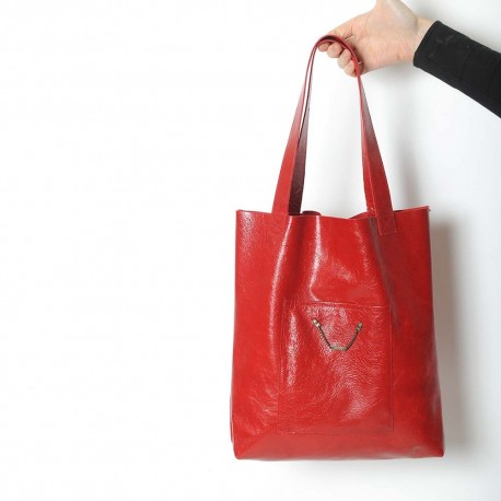 Bright red leather shopping tote bag, with two pockets
