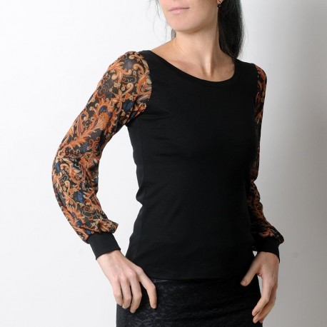 Black top with long orange and blue printed mesh sleeves