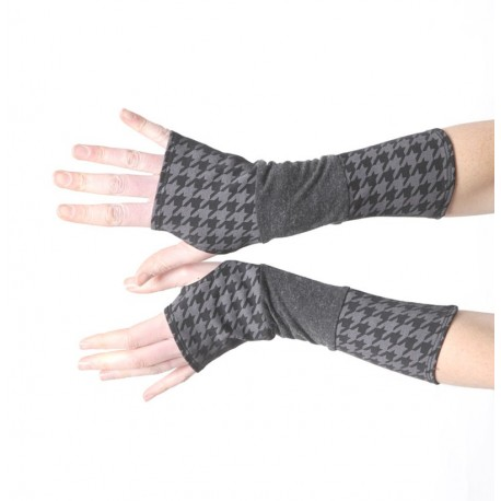 Long jersey armwarmers in a patchwork of grey and houndstooth jersey