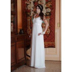 Long white wedding dress with low back neckline and empire waist